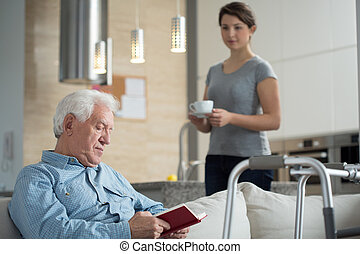 Granddaughter helping her disabled grandpa