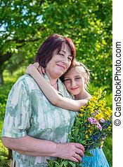 granddaughter hugs her grandmother