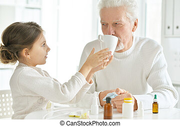Granddaughter takes care of a sick grandfather