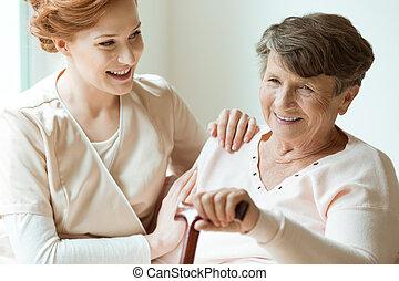 Granddaughter taking care of grandma