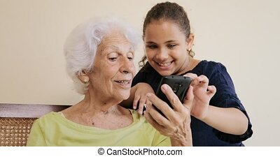 Granddaughter Teaching Grandma How To Use Mobile Phone Smartphone Telephone