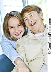 Granddaughter visiting grandmother - Granddaughter giving a...
