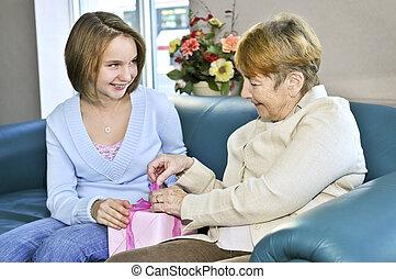Granddaughter visiting grandmother