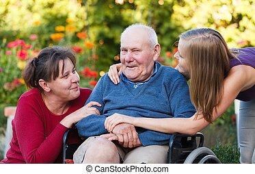 Granddaughter visiting grandpa