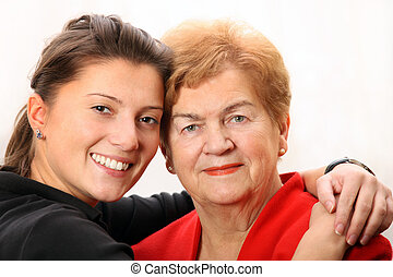 Granddaughter with her grandma - A portrait of a...