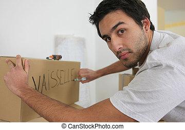grande, caixas, movimento, embalagem, homem