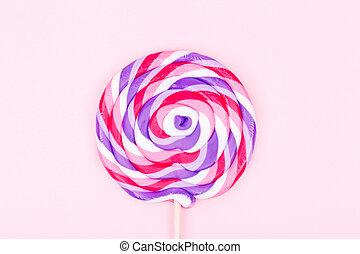 grande, pirulito, ligado, sólido, fundo cor-de-rosa