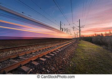 grande vitesse, train passager, dans mouvement, à, coucher soleil