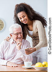 Grandfather and adult granddaughter spending time together