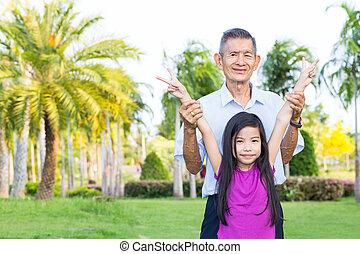 Grandfather and grandchild have fun