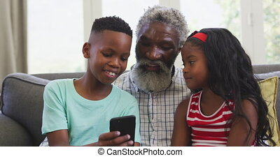 Grandfather and grandchild spending time together - Senior ...