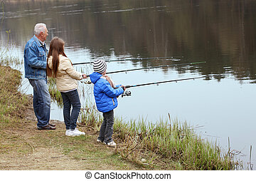 Grandfather and grandchildren are fishing