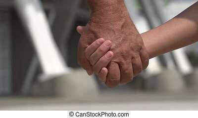 Grandfather and Granddaughter Holding Hands