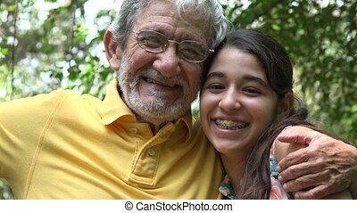 Grandfather and Granddaughter in Forest