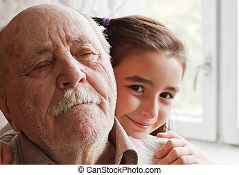 grandfather and granddaughter - little granddaughter loving...