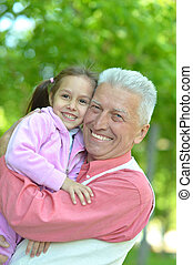 Grandfather and granddaughter together - Grandfather and his...