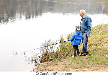 Grandfather and grandson are fishing