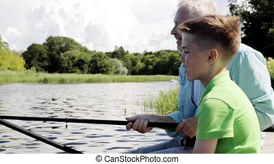 grandfather and grandson fishing on river berth 10 - family,...