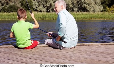 grandfather and grandson fishing on river berth 18 - family,...