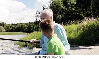 grandfather and grandson fishing on river berth 7 - family,...