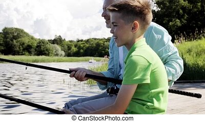 grandfather and grandson fishing on river berth 8 - family,...