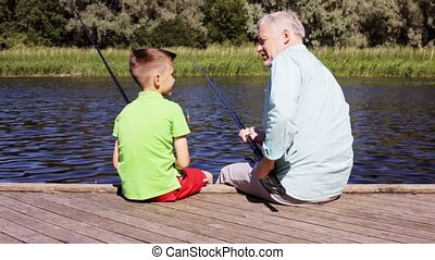 grandfather and grandson fishing on river berth 20 - family,...