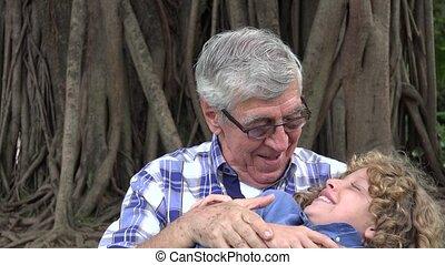 Grandfather and Grandson Having Fun
