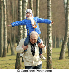 Grandfather and grandson laughing