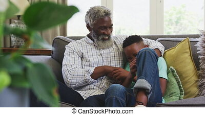 Grandfather and grandson spending time together - Senior ...