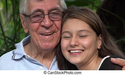 Grandfather And Teen Girl Smiling