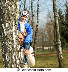 Grandfather carries grandson on his shoulders