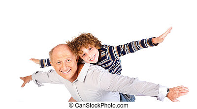 Grandfather giving grandson piggy-back