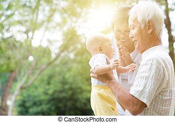 Grandfather, grandmother and grandson portrait.