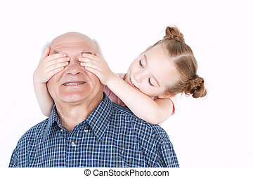Grandfather having fun with his granddaughter - Portrait of...