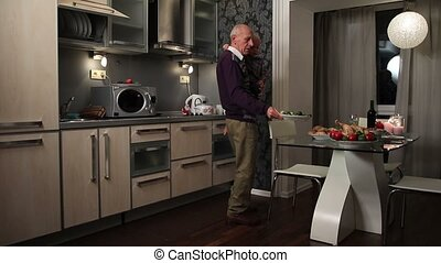 Grandfather holding boy and setting festive table