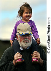 Grandfather plays with grand daughter