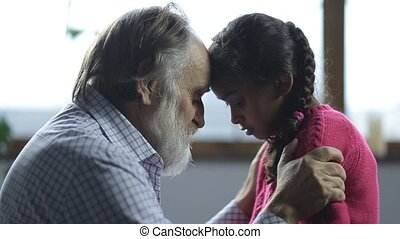 Grandfather scolding his pouting granddaughter - Handsome...