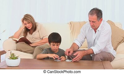 Grandfather shuffling cards