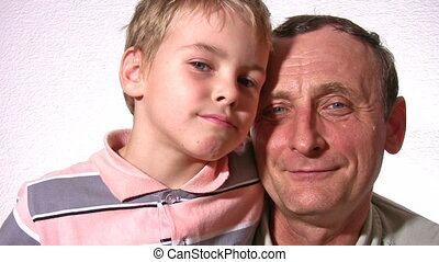 grandfather with grandson faces - Grandfather with grandson...