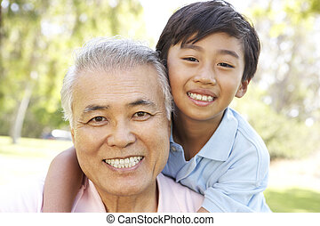 Grandfather With Grandson In Park