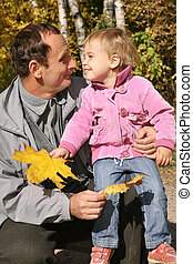 grandfather with the granddaughter in the park in autumn 3
