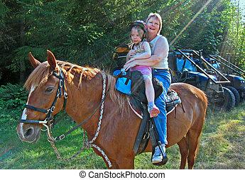 Grandma and Grandchild Riding Horses