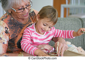 Grandma and granddaughter playing a game