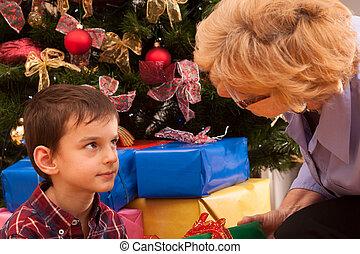Grandma and grandson with christmas tree