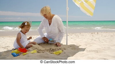 Grandma and Little Girl Bonding at the Beach - Grandma and...
