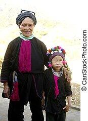 "Grandma Black Dao ""Tien"" and his little girl"