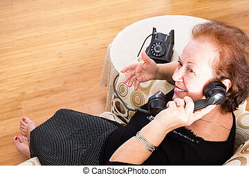 Grandma chatting on an old rotary telephone