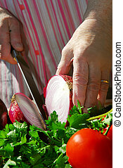 Grandma cooking - Hands of an elderly woman cooking with...