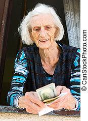 Grandma counting retirement money at home