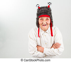 grandma in funny hat - very old lady in funny fur hat with...
